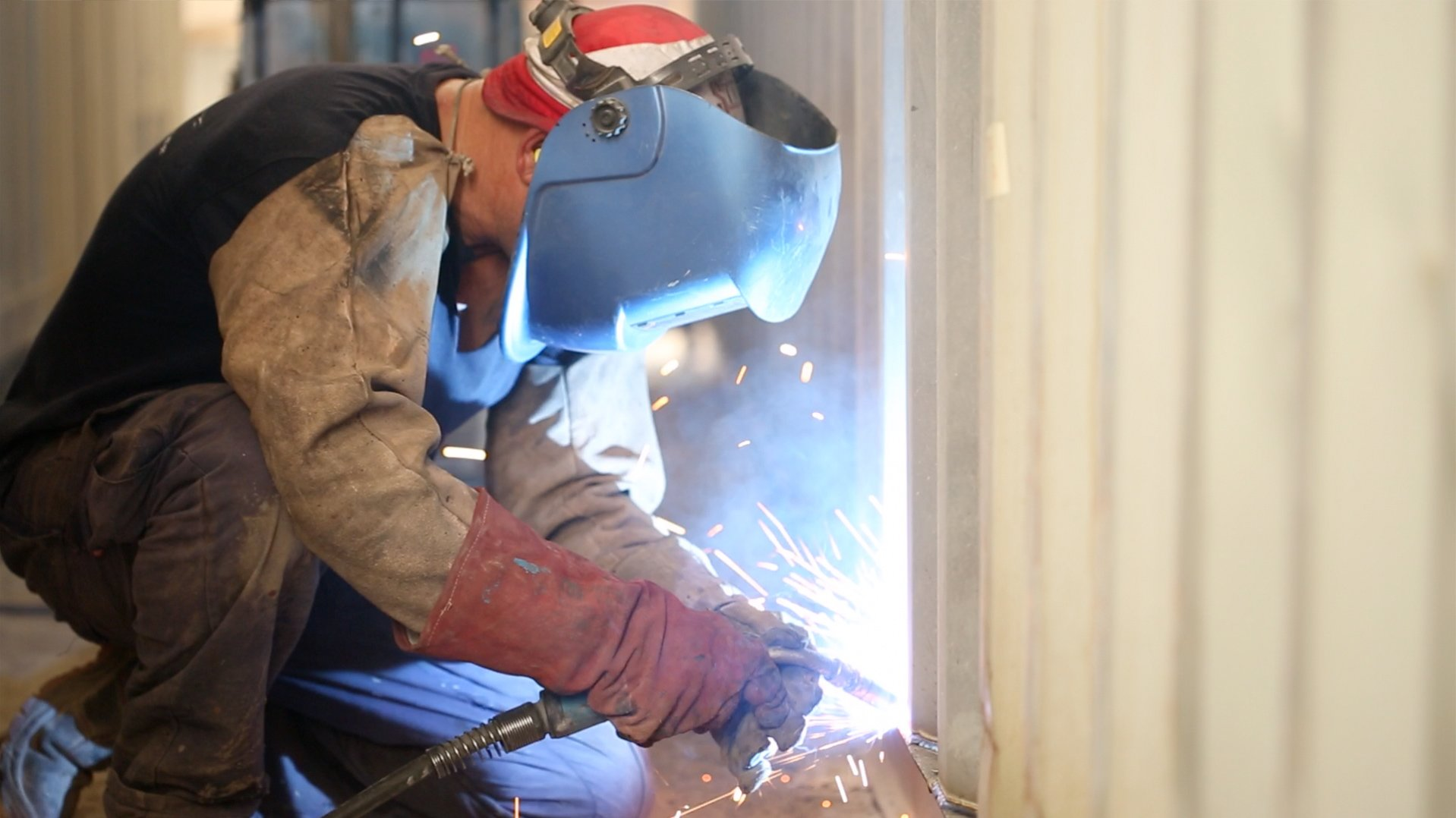 Man welding a container